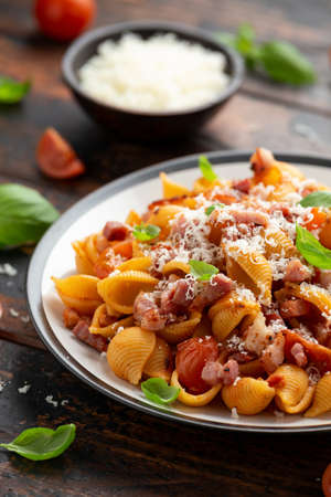 Photo for Conchiglie alla Amatriciana pasta with pancetta bacon, tomatoes and pecorino cheese. Healthy Italian food - Royalty Free Image