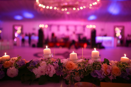 Flaming candles and flowers decoration