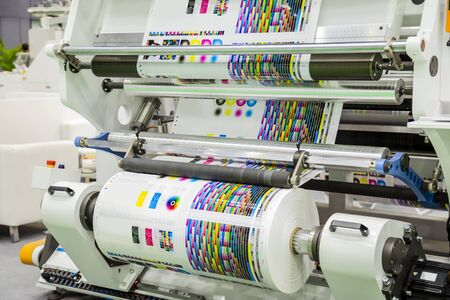 Photo pour Large offset printing press or magazine running a long roll off paper in production line of industrial printer machine. - image libre de droit