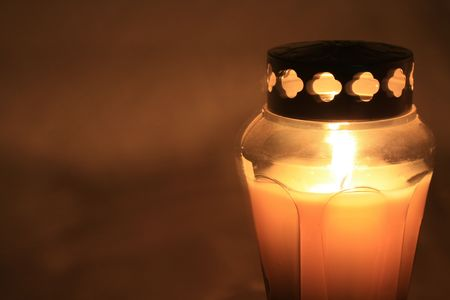 Burning votive or grave light with metal cover