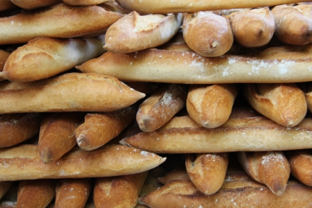 Fresh baguettes, tradiotional French bread at a market in France
