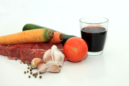 Raw beef, a zucchini or courgette, some garlic, carrot and a tomato