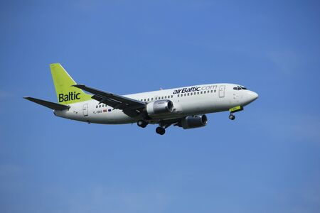 Amsterdam, the Netherlands - July 21st 2016: PH-BGO KLM Royal Dutch AirliYL-BBS Air Baltic Boeing 737,  approaching Polderbaan runway at Schiphol Amsterdam Airport, arriving from Riga, Latvia