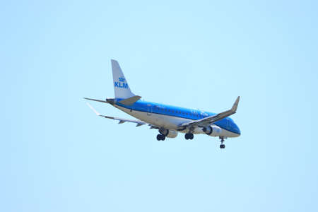Amsterdam, the Netherlands - August, 7th 2020: PH-EXT KLM Cityhopper Embraer ERJ-175STD final approach to Polderbaan runway at Schiphol Amsterdam Airport, the Netherlands