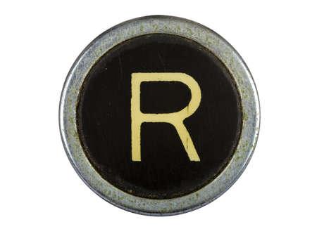 Vintage typewriter letter R isolated on white