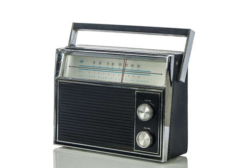 1960 s era transistor radio isolated on a white background