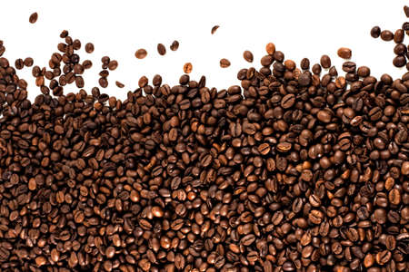 brown coffee beans over a white background