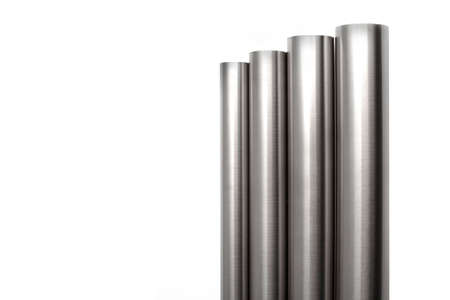 four brushed stainless steel pipes, isolated over white
