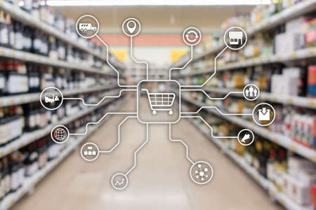 Foto de Retail marketing channels E-commerce Shopping automation concept on blurred supermarket background - Imagen libre de derechos