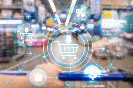 Foto de Shopping cart Ecommerce Marketing channel distribution concept on supermarket background - Imagen libre de derechos