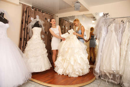 A Bride-To-Be shopping for a wedding dress in a Bridal Boutique.