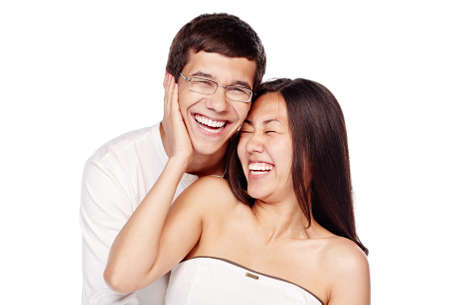 Photo pour Portrait of young lovely interracial couple, hispanic man and asian girl, hugging and laughing out loud isolated on white background - laughter concept - image libre de droit