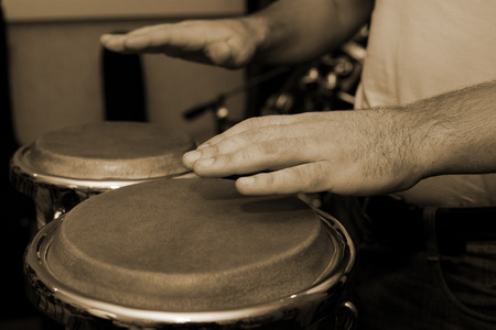 Hands of man playing the bongos