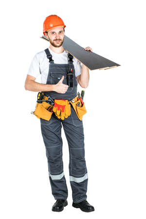 Photo pour A construction man with boards or laminate in his hands. Repair and construction. Isolated over white background - image libre de droit