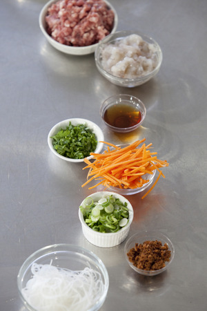 Julienne cut carrot and other stir-fry ingredients on a kitchen counter