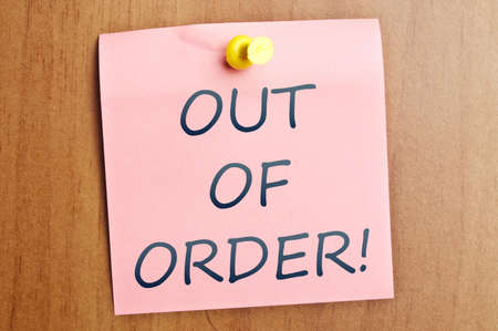 Out of order word  post it on wooden wall
