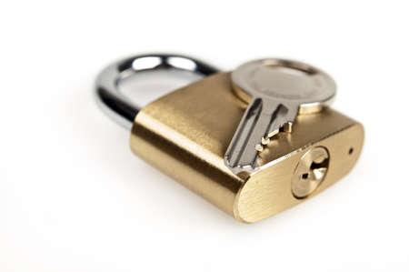 Photo pour Padlock and key on white - image libre de droit