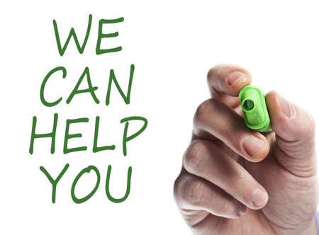 Foto de Hand write with green marker We can help you - Imagen libre de derechos