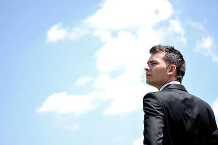 Business man closeup on the sky