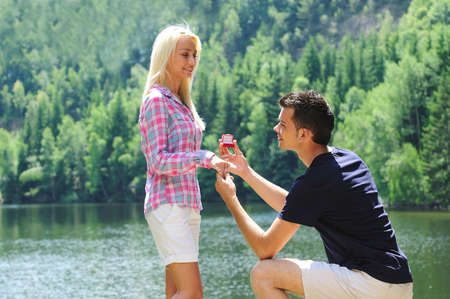 Photo for Young man propose his girlfriend - Royalty Free Image