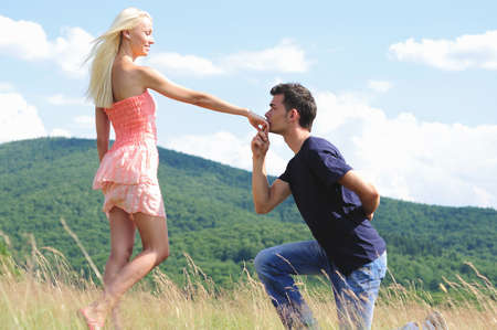 Boyfriend kiss girl hand in nature
