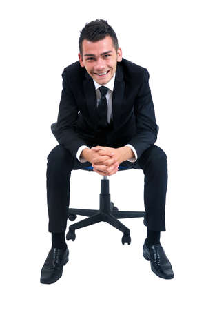 Isolated young business man standing on chair