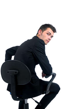 Photo for Isolated young business man sitting on chair - Royalty Free Image