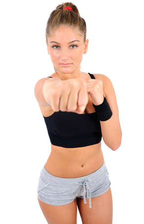 Isolated young fitness woman fight