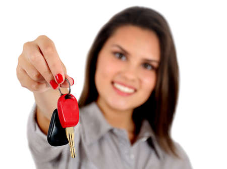 Isolated young business woman showing key