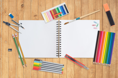 Blank Paper and school tools on wood background.copy space