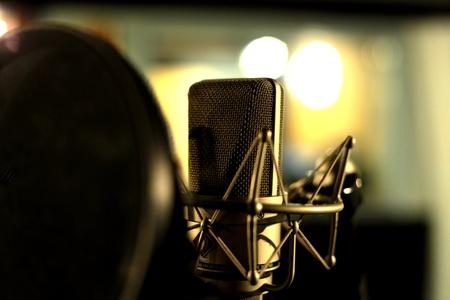 Studio condenser microphone behind pop filter