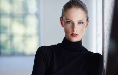 Portrait of luxury brunette woman in black sweater.