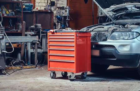Photo pour Red tool box in a garage. - image libre de droit