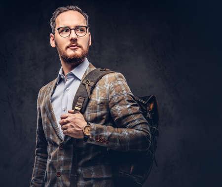 Traveler. Studio portrait of a handsome bearded man wearing a ca