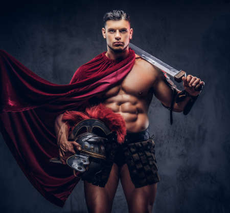 Photo for Brutal ancient Greece warrior with a muscular body in battle uniforms - Royalty Free Image
