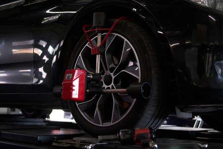 Photo pour Closeup photoshoot of process or tyre balancing at dark auto service. - image libre de droit