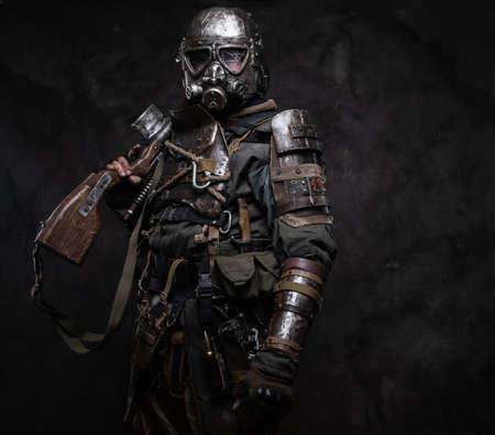 Foto de Portrait of a man in  costume of dark apocalypse warrior at photo studio. - Imagen libre de derechos