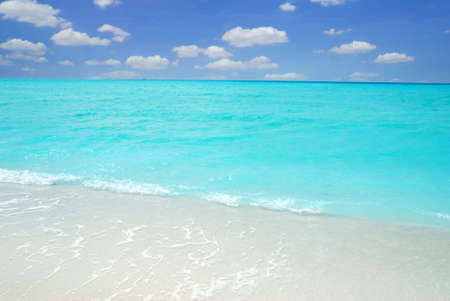 Beautiful crystal clear Maldivian sea and a blue sky with clouds