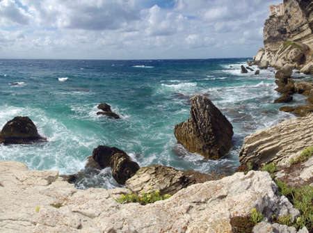 Wild and beautiful coast of c Corsica with spectacular stone formations in the sea