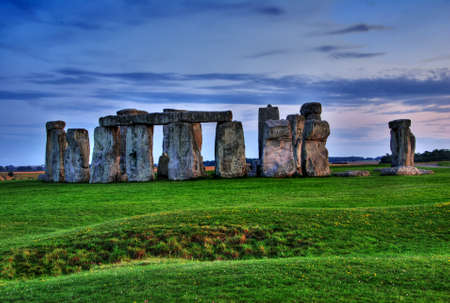 Historical monument Stonehenge not far from town of Amesbury at sunset, England. HDR