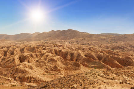 Not only sand dunes, but also arid mountains are a face of mighty desert Sahara