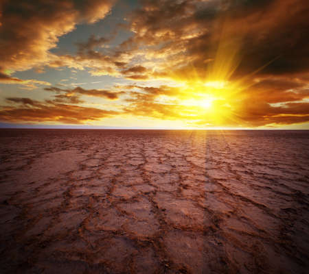 Beautiful dramatic sunrise over great dried-up salt lake Chott el Djerid in Tunisia