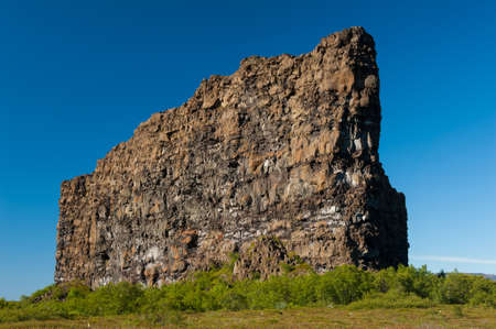 Eyjan rock in Asbyrgi  Asbyrgi is a horseshoe-shaped canyon in the national park Jokulsargljufur in the North of Iceland  The rocky walls of the canyon are up to 100 high and very steep  The canyon was probably formed during great glacial floods