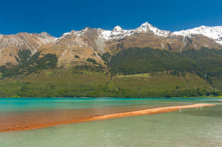 Beautiful lake Wakatipu with mighty mountains at Glenorchy. Otago region New Zealand