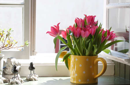 bouquet of tulips on the windowsill