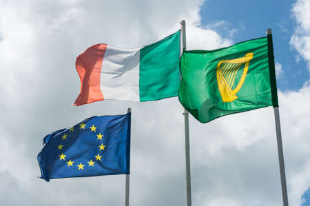 Irish and european flags blowing in the wind