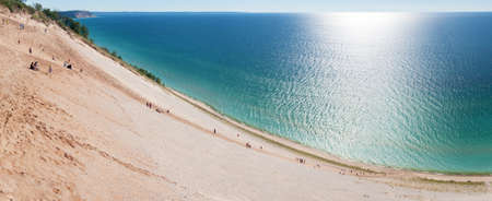 Tourists climbing up and down a popular dune overlook at Sleeping Bear Dunes.