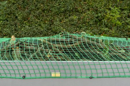 Photo for Car trailer with net for load securing - Royalty Free Image