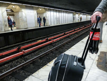 Bucharest, Romania, 21 February 2016: People are waiting for the metro in Piata Romana subway station in Bucharest.