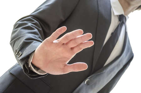 Cropped view of a man refusing an offer with stop gesture